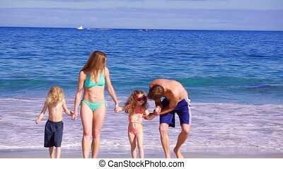 Happy family walking while holding their hands