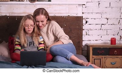 Happy family watching a movie on the laptop
