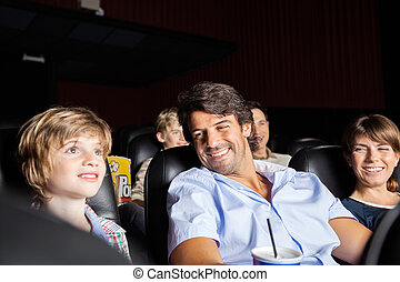 Happy Family Watching Movie In Theater