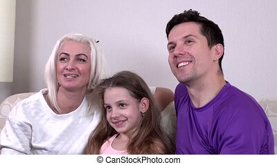 Happy family watching TV together, closeup