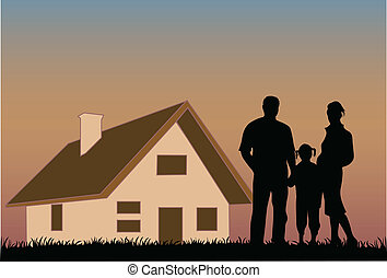 Happy family with a house in the background