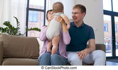 happy family with baby boy at home