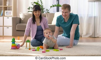 happy family with baby boy playing at home