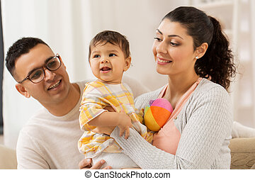 happy family with baby daughter at home