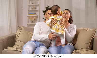 happy family with baby girl at home - family, parenthood and...