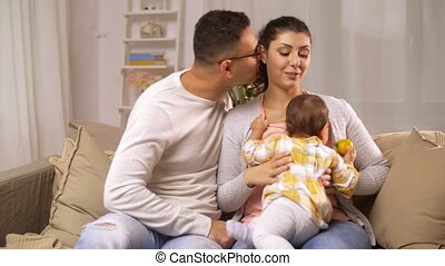happy family with baby girl at home
