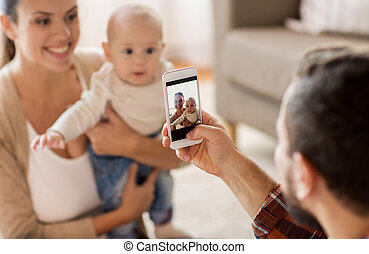happy family with baby photographing at home
