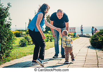 Happy family with baby son on nature background