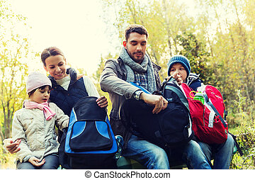 happy family with backpacks at camp