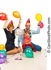 Happy family with balloons at party