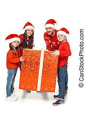 family with big christmas present