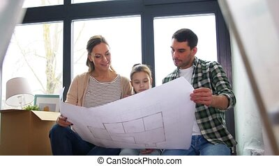 happy family with blueprint moving to new home - mortgage, ...