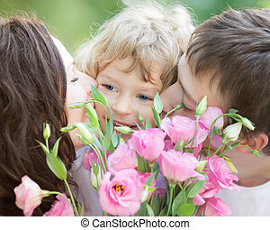 Happy family with bouquet of spring flowers
