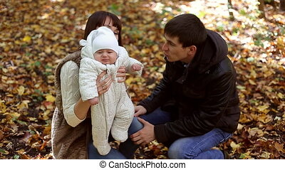 Family with child go in autumn park