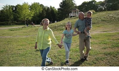Happy family with children having fun in park