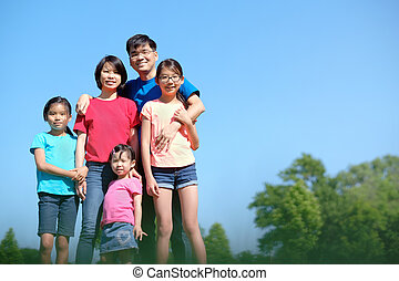 Happy family with children outdoors during summer