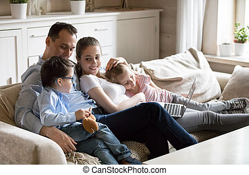 Happy family with children spend time at home