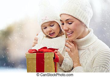 christmas gift - happy family with christmas gift