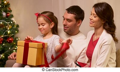 happy family with christmas present at home