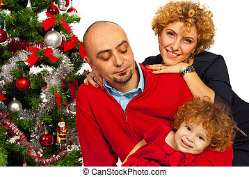 Happy family with Christmas tree