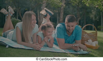 Happy family with daughter resting in nature