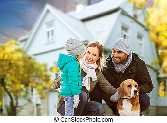 happy family with dog over house in autumn