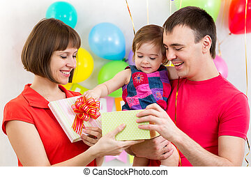 happy family with gift for kid girl