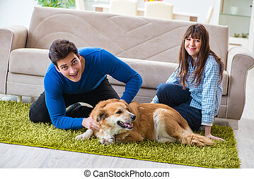 Happy family with golden retriever dog