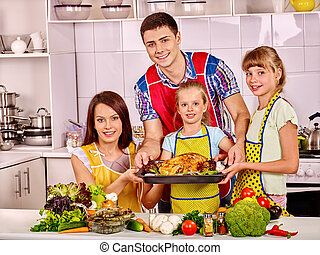 Happy family with grandmother at kitchen.