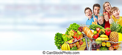 Happy family with grocery shopping cart.
