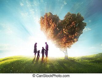 Happy family with Heart shaped tree