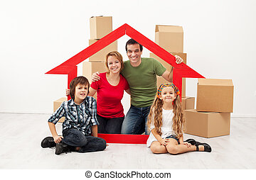 Happy family with kids moving into a new home - sitting with...