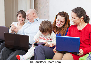Happy family  with laptopos at home