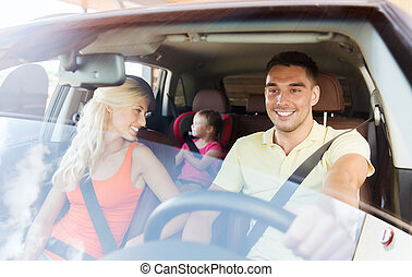 happy family with little child driving in car