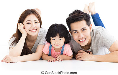 happy family with little girl playing on the floor