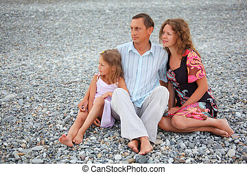 Happy family with little girl sitti