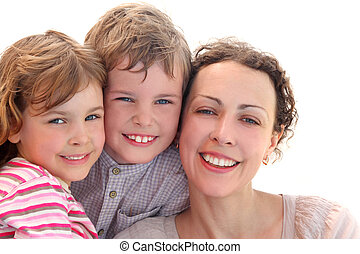 happy family with mother, daughter and son smiling and looking at camera, isolated on white