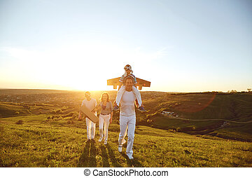 Happy family with nature in the evening at sunset