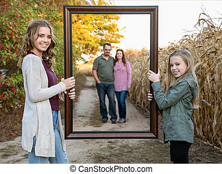 happy family with picture frame