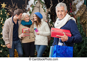 Happy Family With Presents At Christmas Store