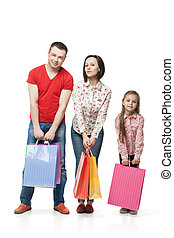 Happy family with shopping bags