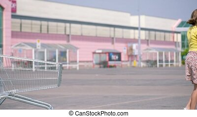 Happy family with shopping carts