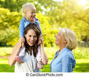Happy family with smiling mother and grandmother