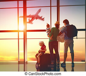 family with suitcases - Happy family with suitcases in the...