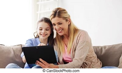 happy family with tablet pc at home