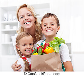 Happy family with the groceries - Happy family with the ...