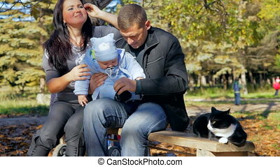 happy family with toddler and cat