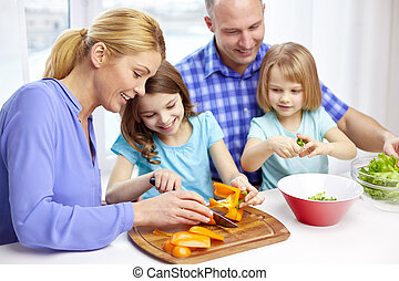 happy family with two kids cooking at home