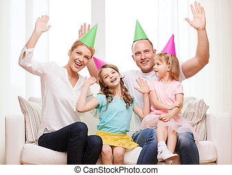 happy family with two kids in hats celebrating