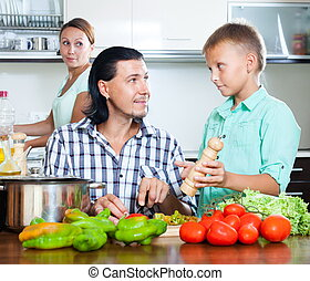 Happy family with vegetables